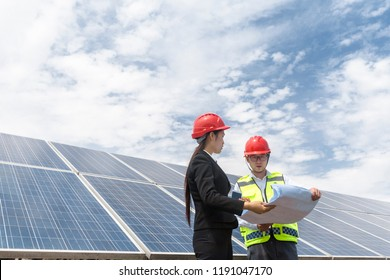 A woman engineer and an electrical energy tester conducted performance tests at an outdoor wind power plant in Asia and conducted data analysis and discussions on the site.