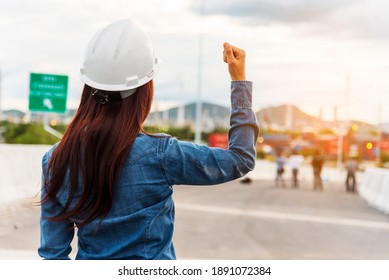 Woman engineer entrepreneur construction industry worker. Female engineer working refinery oil plant manufacturing. Young civil engineering construction wear hard hat safety helmet construction site.
