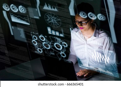 woman engineer looking at various information in screen of futuristic interface.