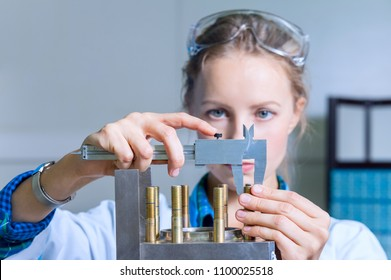 Woman engineer measures the size of the device