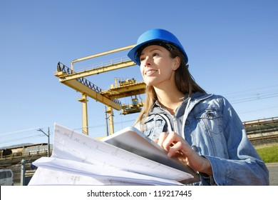Woman engineer on building site using tablet