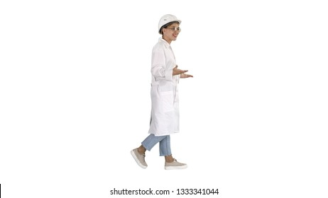 Woman engineer walkin and talking emotionaly on white background.