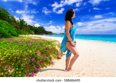 Woman enjoing sun holidays at the tropical beach