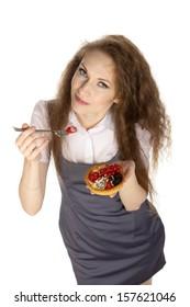 Woman enjoy cake, isolated.