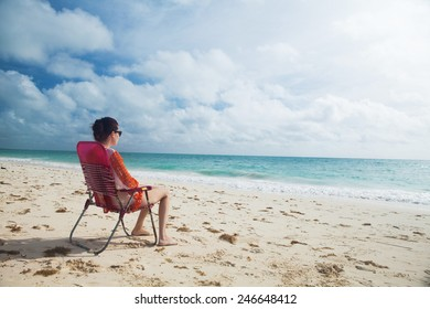 Woman enjoy day at the tropical beach.