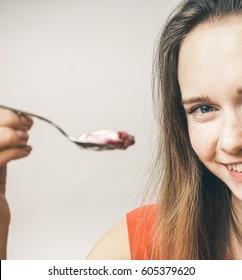 Woman enjoy eating yogurt,offer,diet