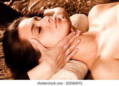 woman enjoy in face massage in spa salon