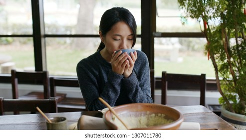 Woman enjoy the Hakka Lei Cha at tea house