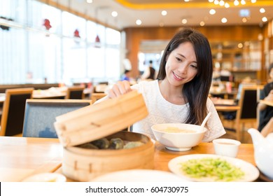 Woman enjoy meal in chinese restaurant