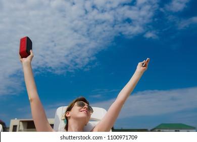Woman enjoy music from portable speaker