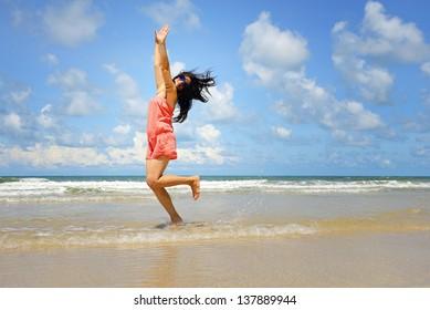 Woman enjoy relaxing on the beach
