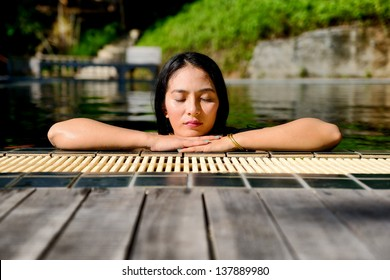 Woman enjoy relaxing in the pool