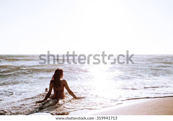 woman enjoy in sea water on sandy beach at Ada Bojana, Montenegro