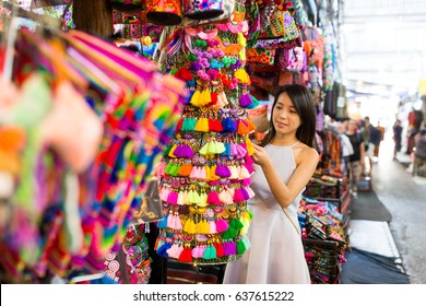 Woman enjoy shopping in weekend market