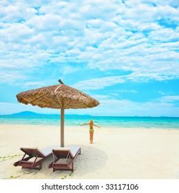 Woman enjoy sun on the tropical beach
