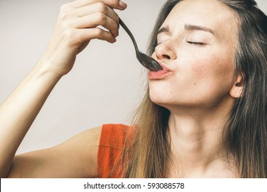Woman enjoy tasty food,full mouth