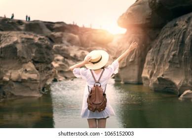 """Woman is enjoy travel at Canyon of Thailand """"Sam Pan Bok"""" in Ubon Ratchathani, Thailand."""