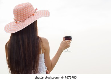 woman enjoy wine in glass on white background