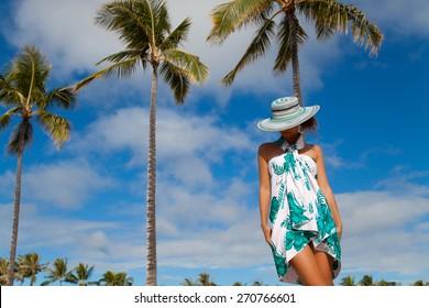 Woman, enjoying beach getaway - Hawaiian beach vacation. Enjoying every minute of this vacation. Summer in Waikiki beach, Honolulu city, Oahu, Hawaii, USA.