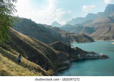 Woman is enjoying the Beautiful lake view in the Elbrus region