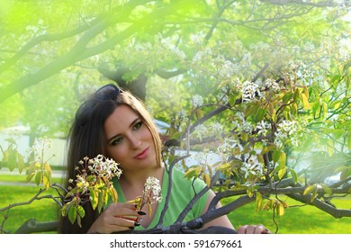 Woman enjoying a beautiful spring day outside. Portrait of a beautiful Caucasian girl in spring background. It's a sunny day, positive energy is all around!!!