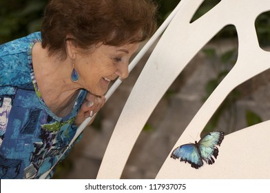 Woman enjoying the butterflies at the Butterfly Palace in Branson, Missouri