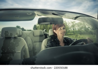 Woman enjoying driving her convertible car