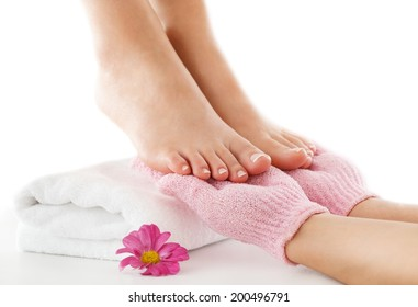 Woman is enjoying foot treatment.