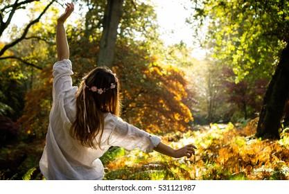 Woman enjoying forest in autumn
