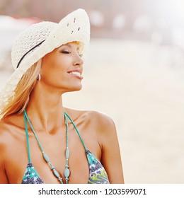 Woman enjoying freedom. Summertime portrait. Close up