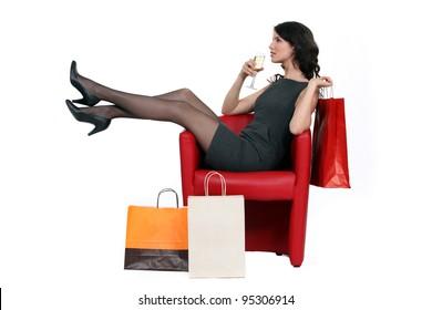 Woman enjoying a glass of wine during a shopping trip