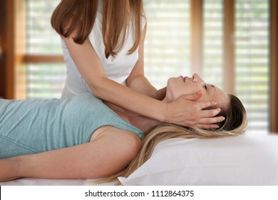 Woman enjoying head massage. Acupressure treatment. Relaxation and Alternative medicine conept