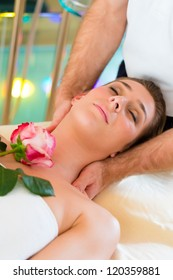 Woman enjoying head massage or lymphatic drainage in a spa