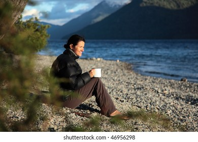 A woman enjoying her first cup of coffee.