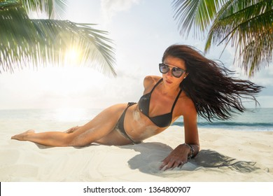 Woman enjoying her holidays at the tropical beach - UNRETOUCHED body.