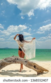Woman enjoying her holidays at the tropical beach in Vietnam - UNRETOUCHED body.