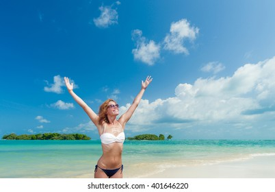 WOman enjoying her vacation on the tropical beach