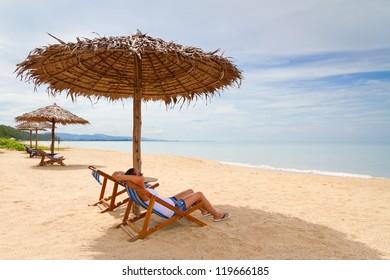 Woman enjoying holidays under parasol at Andaman Sea