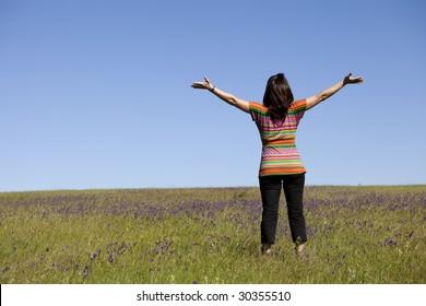 woman enjoying life in a green field