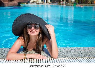 woman enjoying life in a swimming pool