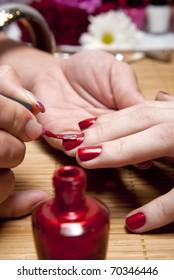 A woman enjoying a manicure.