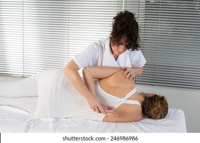A woman enjoying a massage at the health spa