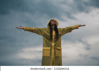 Woman enjoying rainy grey autumn day outdoors. soft daylight.