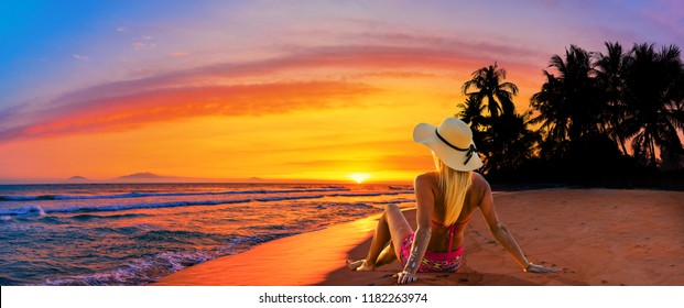 Woman enjoying serene ocean nature during travel holidays vacation outdoors.