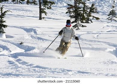 A woman enjoying skiing on powder