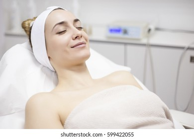 Woman enjoying spa therapy in beauty salon