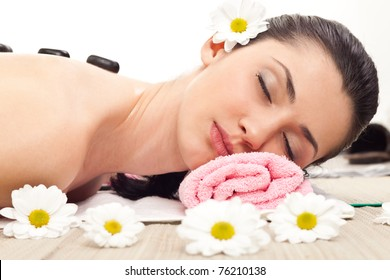 woman enjoying  in spa therapy with stone