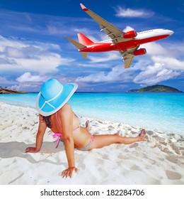 Woman enjoying tropical holidays on the beach