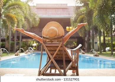 woman enjoying vacations near swimming pool