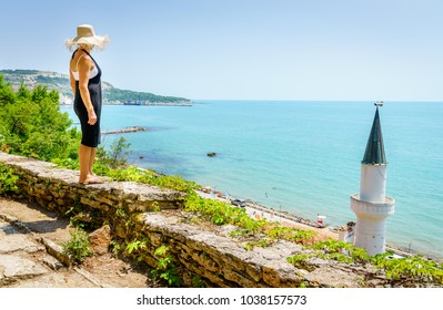 A woman is enjoying a view of Black Sea at the Balchik Palace gardens in Bulgaria
